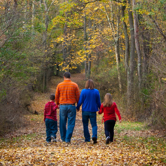 Family Walking by Trees